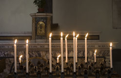 Candles in a dark church Royalty Free Stock Photo