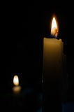 Candles in a dark. Classic white candles on fire Royalty Free Stock Image