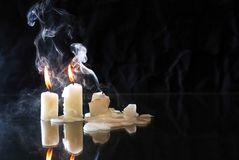 Candles On Dark. Set of extinguished candles with fire and smoke on nice dark background royalty free stock photography