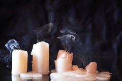 Candles On Dark. Set of extinguished candles on nice dark background stock image