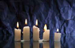 Candles On Dark. Set of lighting candles with fire and smoke on nice dark background stock images