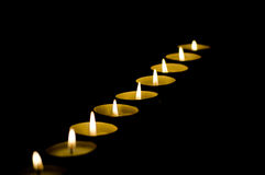 Candles in darkness Stock Photography