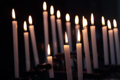 Candles in the darkness Stock Photos