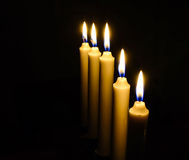 Candles in darkness Royalty Free Stock Images