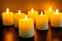 Candles in darkness Stock Images