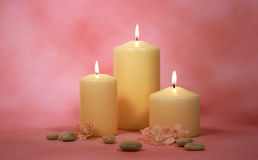 Candles with Deco. Three Candles with decoration and a purple background Stock Photo