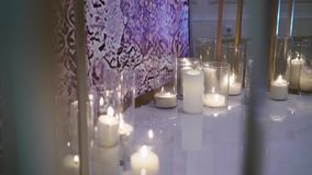 Candles decoration at wedding ceremony. Indoors stock footage