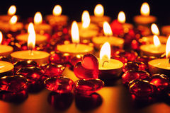 Candles and decorative red heart Stock Images