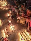 Candles For Dev Diwali. VARANASI, INDIA - NOVEMBER 14, 2016: On the night of Dev Diwali in Varanasi, Hindu women light candles to illuminate the festival while royalty free stock images