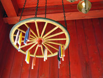 Candles Drying. Candle hung to dry on wagon wheel royalty free stock photography