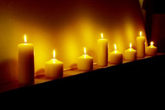 Candles_2. Eight candles of hope shining in the dark Stock Photos