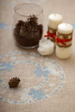Candles on embroidered tablecloth Royalty Free Stock Images