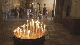 Candles and the entrance to the church of the holy sepulchre in jerusalem