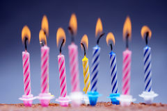 Candles on a festive cake. On a light background Royalty Free Stock Photos