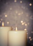 Candles with flame on bokeh Royalty Free Stock Image