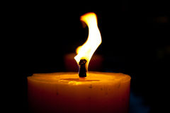 Candles. The candles flame in the dark closeup Royalty Free Stock Photography