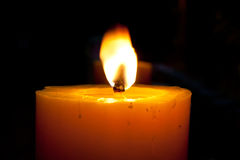 Candles. The candles flame in the dark closeup Stock Photos