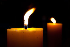 Candles. The candles flame in the dark closeup Royalty Free Stock Photo