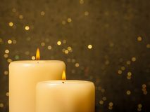 Candles with flame on golden bokeh Stock Image