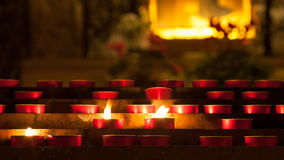 Candles with flame inside a church Royalty Free Stock Images