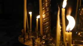 Candles flaming in candlestick in church.  stock footage