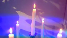 Candles Flaming in Candlestick. With Shadows Of Tree Leaves And Romantic Colors stock video