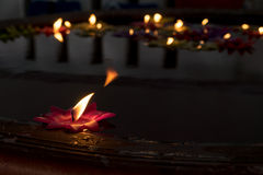 Candles floating in the water Stock Photos