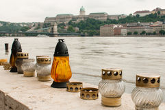 Candles and Flood, Budapest. Candles placed in the hope of preventing flooding along the Danube River. The Danube River flooded Central Europe in 2013. In Royalty Free Stock Photo
