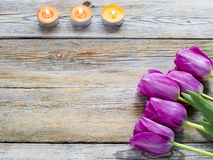 Candles with flower. On wooden background royalty free stock image