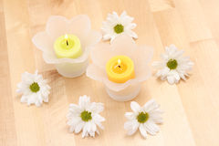 Candles and flowers Stock Photos