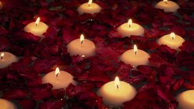 Candles and flowers in the bath. Floating candles in the bath romantic concept stock footage
