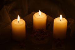 Candles with flowers and festive tablecloth Royalty Free Stock Photo
