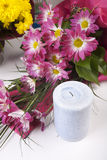 Candles and flowers isolated on white Stock Images