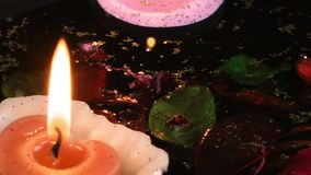 Candles Flowers and Leaves on the Water. Video stock footage