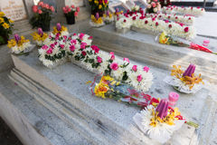 Candles and Flowers over Grave in The Annual Blessing of Graves at Ratchaburi Province, Thailand Royalty Free Stock Image