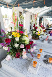 Candles and Flowers over Grave in The Annual Blessing of Graves at Ratchaburi Province, Thailand Stock Images