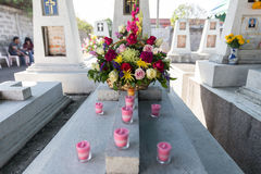 Candles and Flowers over Grave in The Annual Blessing of Graves at Ratchaburi Province, Thailand Royalty Free Stock Photo