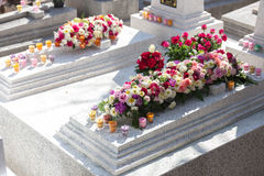 Candles and Flowers over Grave in The Annual Blessing of Graves at Ratchaburi Province, Thailand Royalty Free Stock Images