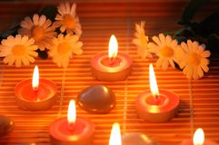 Candles, flowers and pebbles. For aromatherapy treatment Royalty Free Stock Image