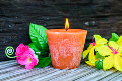 Candles and flowers plastic beautiful. Candle and flowers plastic beautiful Royalty Free Stock Image