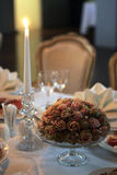 Candles and flowers on table Stock Photo