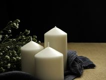 candles and flowers on table stock photography
