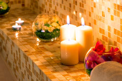 Candles and flowers on the tile in the bath Royalty Free Stock Photography