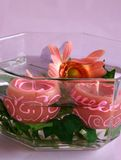 Candles and Flowers in Water. Rose Candles and Flowers in Water, purple background Stock Image