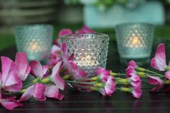 Candles and flowers on the wedding table. Candles flowers wedding table celebration ceremony marriage love emotion royalty free stock images