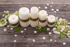 Candles with flowers on  wooden background Royalty Free Stock Images