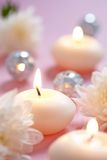Candles and flowers. On wooden table Stock Image