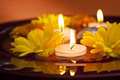 Candles and flowers. Zen like, serene setting with candles Royalty Free Stock Images