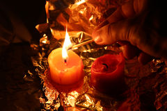 Candles on a foil to light candles at night Stock Photo