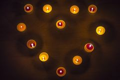 Candles in the form of a heart. Candles set into the form of a heart in the darkness Stock Photography